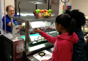 Placing attractive fruit bowls on the serving line, and prompting students to take one, is one of the many ways Fulton County School Nutrition is encouraging healthier food choices in the lunchroom.